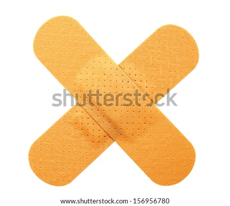 Plaster bands in cross shape - stock photo