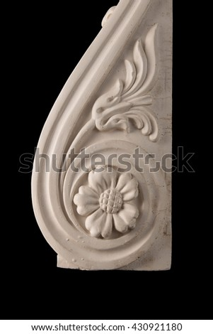 plaster graceful decorations on the columns on a black background - stock photo