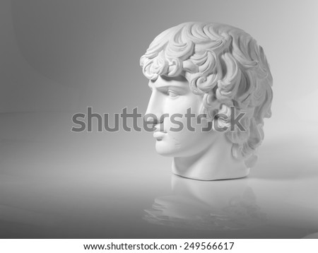 Plaster head on a gray background