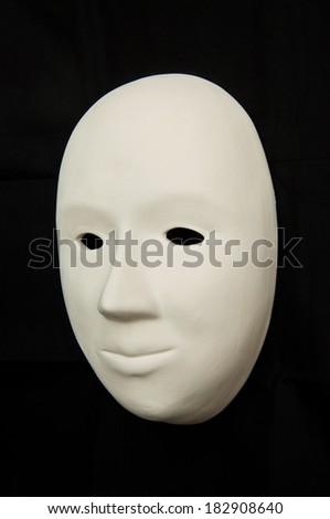 Plaster mask isolated on black - stock photo
