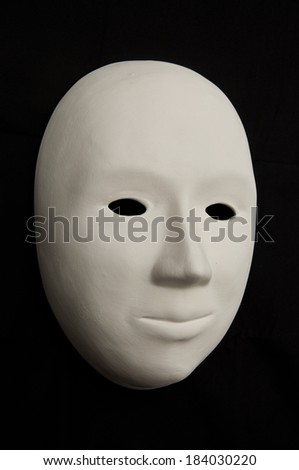 Plaster mask isolated on black - stock photo