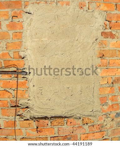 Plaster on a brick wall