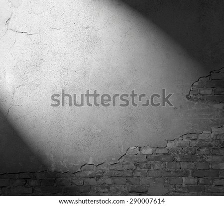plastered wall texture background, black and white background with beam of spot light - stock photo