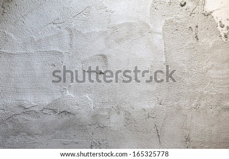 plasterer concrete at wall of house construction  - stock photo