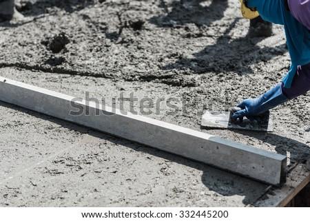 plasterer concrete cement work. leveling concrete slab floor work step of the building construction - stock photo