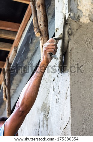 Plastering the poles of the Craftsman house of arms reach  - stock photo