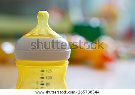 Plastic baby bottle with measure - stock photo