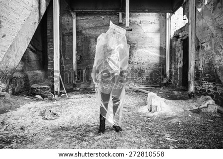 Plastic bag girl trapped screaming, violence - stock photo