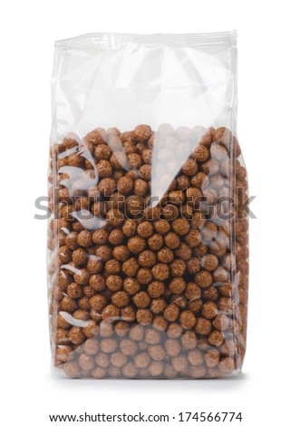 Plastic bag of chocolate cereals balls isolated on white - stock photo
