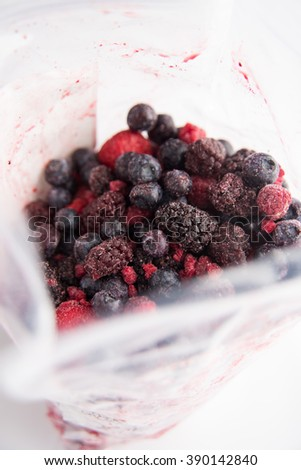 Plastic Bag with Assortment of Frozen Berries - stock photo