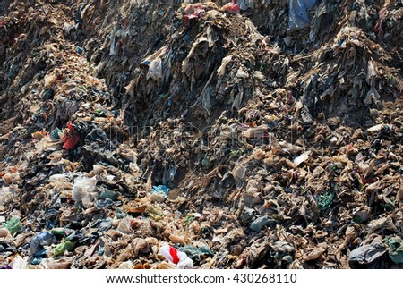 Plastic bags, household garbage and toxic industrial waste contaminates land, soil and groundwater at the largest, most polluted landfill site on the holiday resort island of Bali, Indonesia. - stock photo