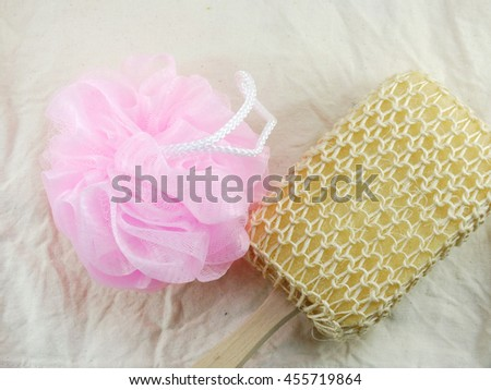 plastic bath puff and sponge for shower cleaning and scrub body - stock photo