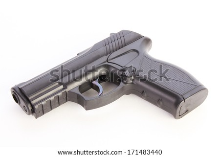 Plastic BB Pistol can easily pass for a large caliber handgun.  On white background with copy space. - stock photo