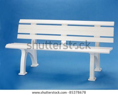 plastic bench blue background - stock photo