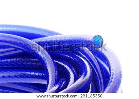 Plastic blue rolled up hose or cable on white  - stock photo
