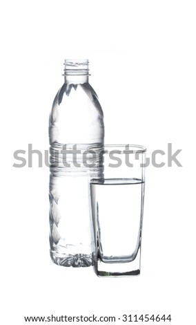 plastic bottle and glass water isolated on white background