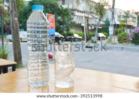plastic bottle and ice glass