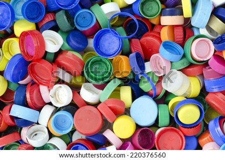 Plastic bottle caps or tops background, recycling concept. - stock photo