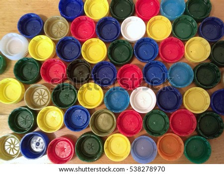 Plastic bottle caps or tops background, recycling concept.
