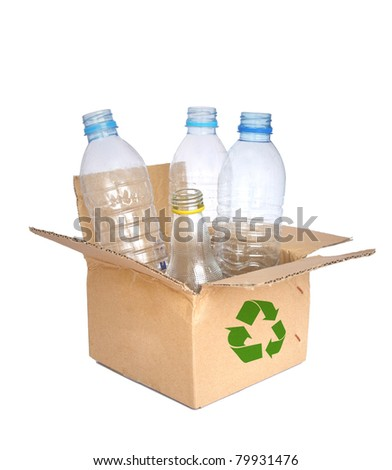 Plastic bottle  in a recycled shipping box. - stock photo