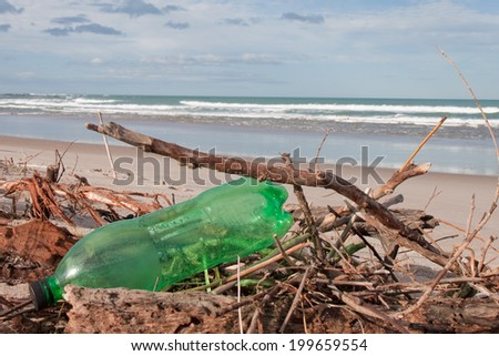 plastic bottle littering a beach  - stock photo