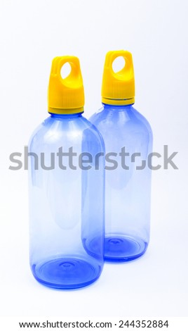 Plastic bottle of drinking water on white - stock photo