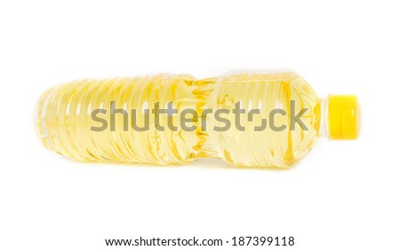 Plastic bottle of vegetable cooking oil on white background