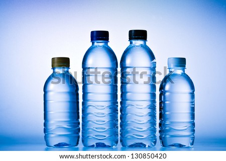 Plastic bottle of water on blue background