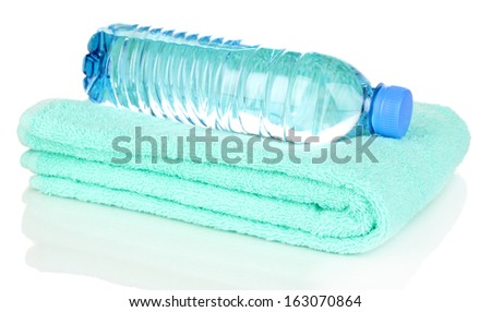 plastic bottle of water on towel isolated on white - stock photo