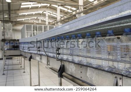 Plastic bottle production.Water bottling plant. - stock photo