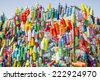 Plastic bottles and containers prepared for recycling in a colorful recycling bin - stock photo