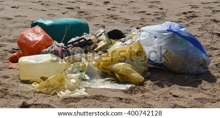 Plastic Bottles and Garbage On The Beach - stock photo