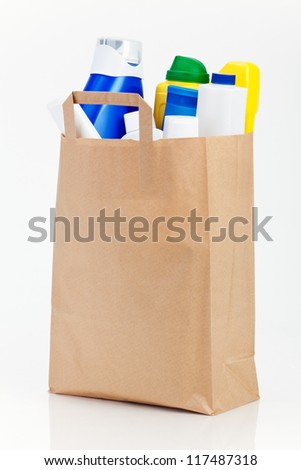 Plastic bottles in brown paper bag on white. - stock photo