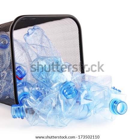 Plastic bottles in recycling bin isolated on white - stock photo