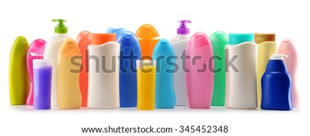 Plastic bottles of body care and beauty products isolated on white - stock photo