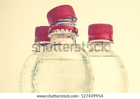 Plastic bottles of drinking water - stock photo