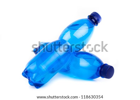 Plastic bottles of drinking water isolated on white - stock photo