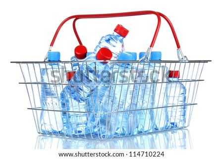 plastic bottles of water in metal basket isolated on white - stock photo