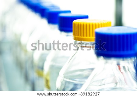Plastic bottles with chemicals in biochemical laboratory