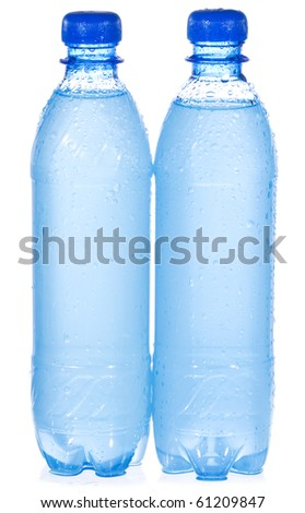 Plastic bottles with water drops on white background