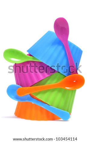 plastic bowls of different colors on a white background - stock photo