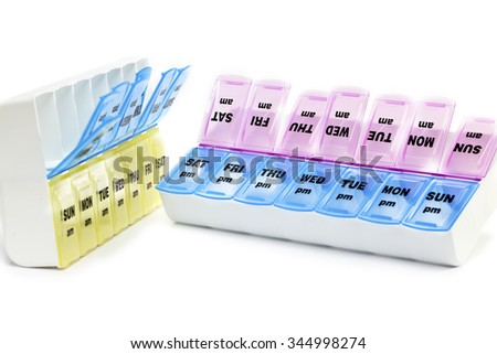 Plastic box with small separations for each day of the week (for example for drugs) - stock photo