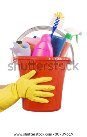 Plastic bucket with cleaning supplies over white