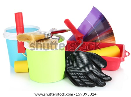 Plastic bucket with paint, roller, brushes and bright palette of colors isolated on white