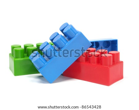 Plastic building blocks on a white background stock photo for Plastic building blocks home construction