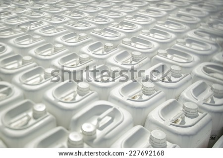 Plastic canisters with toxins for processing plants in farmers' fields - stock photo