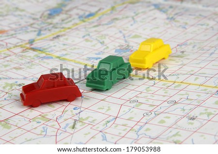 Plastic Cars On Map - stock photo