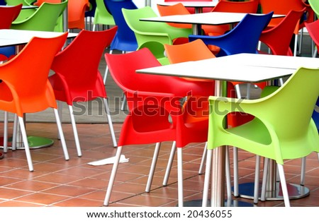 Plastic chairs and tables at fast food restaurant
