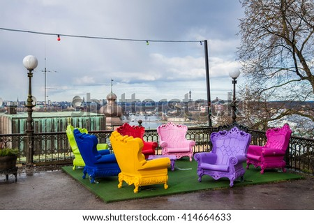 Plastic Chairs In Different Colours. Comfortable Chairs For Outside  Leisure. Cheap Chairs Imitate Rich