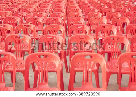 plastic chairs of red color - stock photo